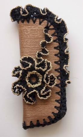 Фото. Чехол из кусочка кожи, обвязанного крючком.  Автор работы - Olga Alex