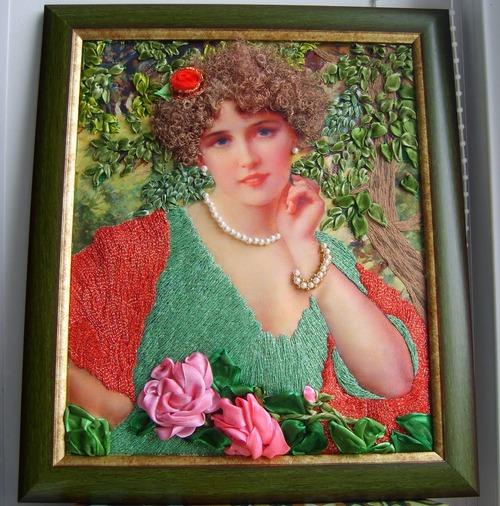 Фото. Вышитая картина - вышивка лентой и нитками, волосы из распущенной ленты, платье и шарф нитки с люриксом. Автор работы - babuliahak