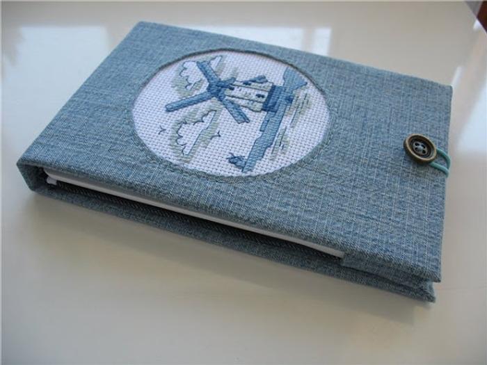 Фото. Первой маленькой вышивке нашлось применение в обложке для электронной книжки. Автор работы - Tan'ushka