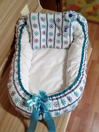 Фото. Кокон-гнездо для новорожденного в морском стиле. Автор работы - ирина клименко