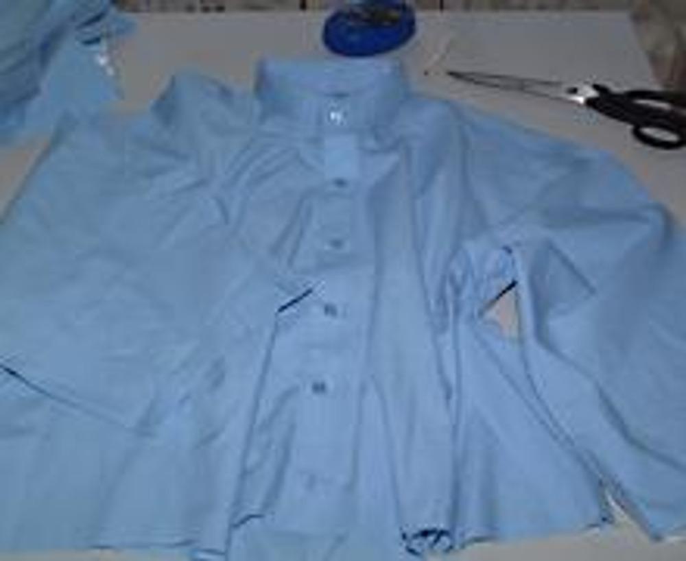 4. Здесь вы видите полуфабрикат для блузки с воротником-стойкой, которая осталась после выпарывания отлетной части.