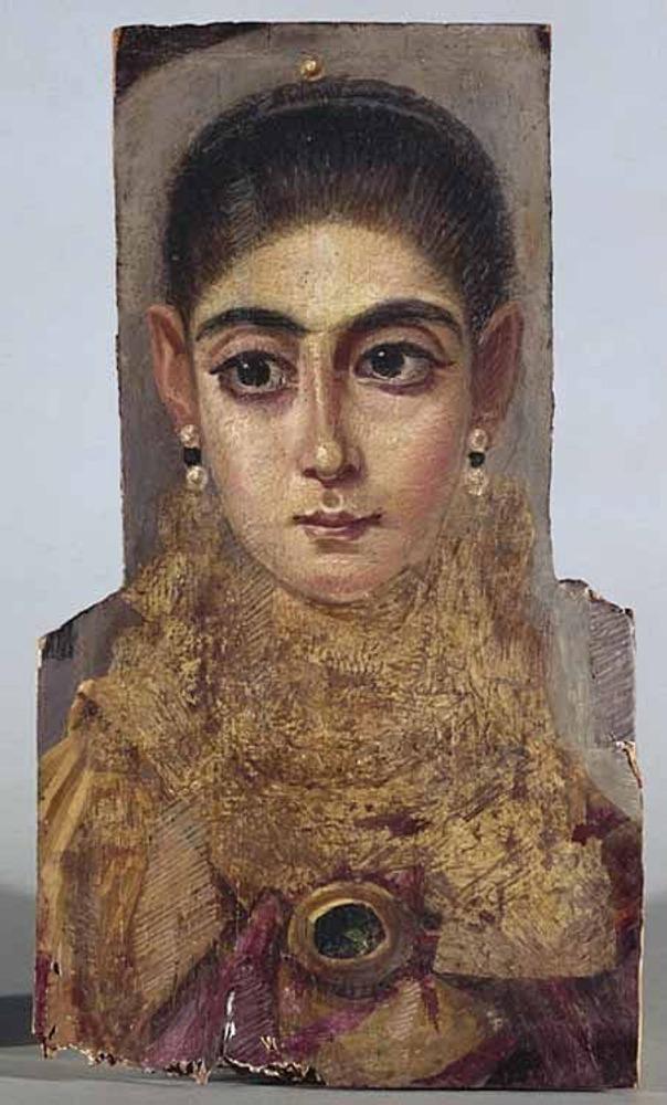 Фото. 26. Фаюмский портрет. 2 век н.э. Дерево, восковые краски, позолота. 42х24см. Лувр. Париж.