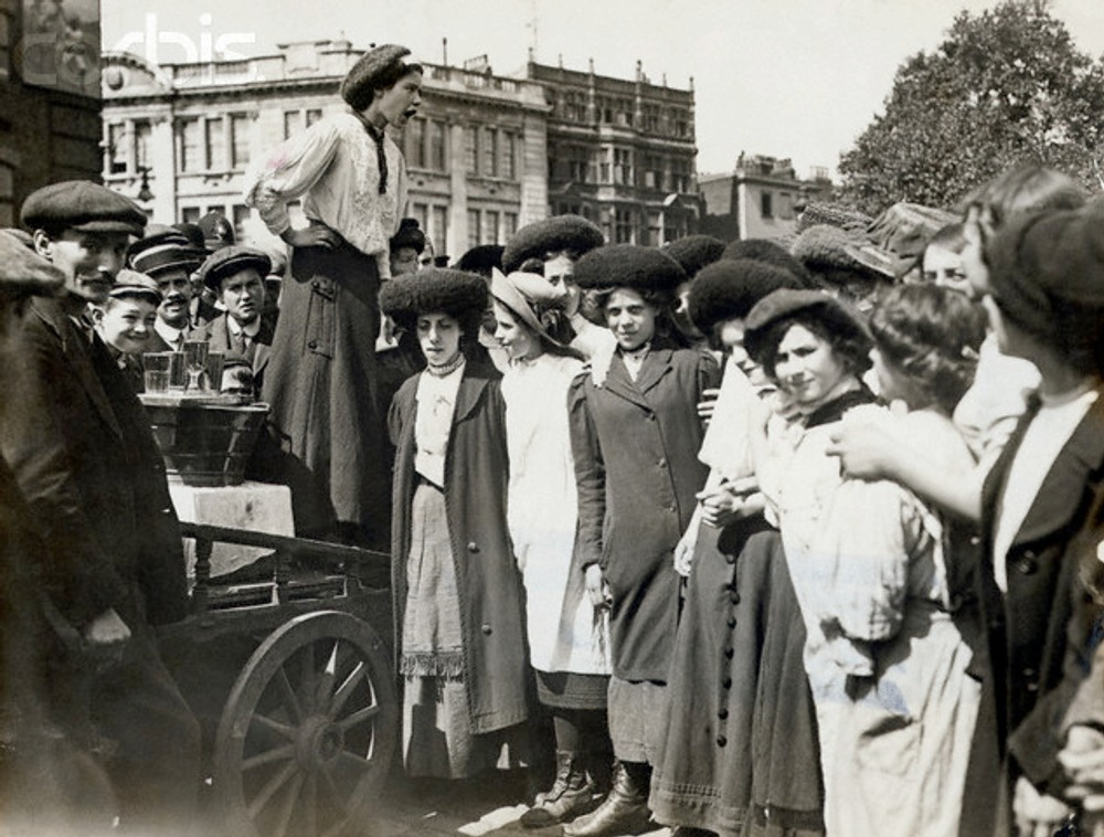 English working girl addressing her co-workers. 1900s