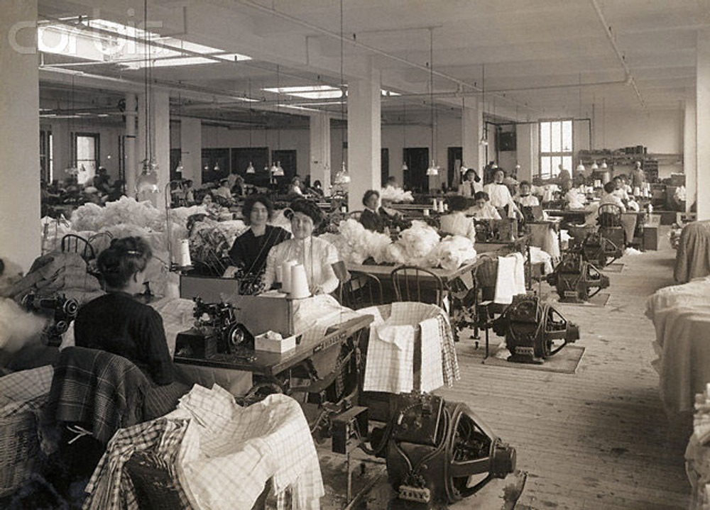 Employees use sewing machines to produce garments at the Waist and Dress Factory of the Rosenthal Brothers 1890s